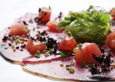 10645120 - forefront of carpaccio of tuna  with diced tomatoes