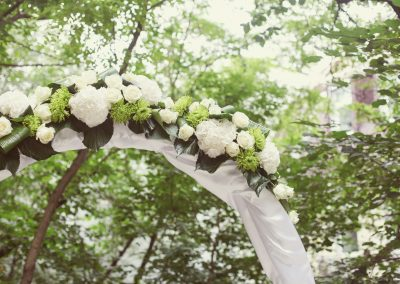 25912758 - wedding arch with flowers on the grass